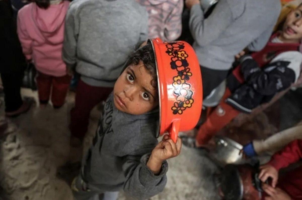 عکسی زیبا و باحال از صف توزیع غذای رایگان در نوار غزه