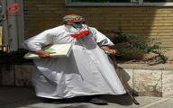 عکس:مرد کفن پوش با عصا و قرآن در ستاد انتخابات
