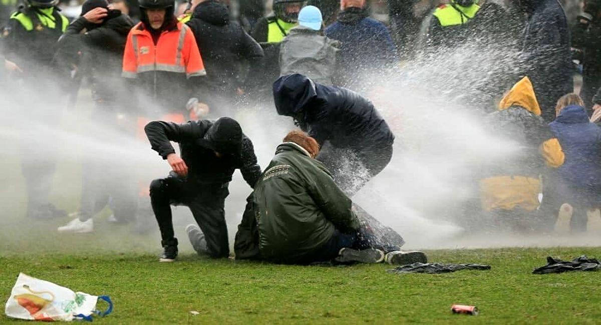 شورش و آتش بازی در پایتخت هلند در اعتراض به محدودیت های کرونایی